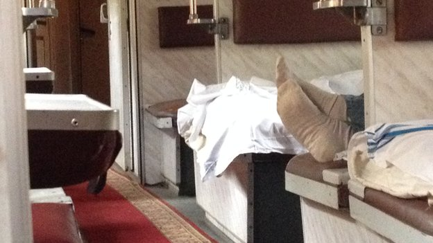 Pair of feet on a bed in the train carriage