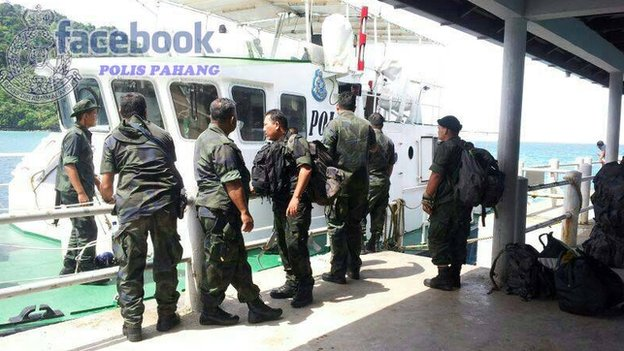 Malaysian Police officers engaged in the search