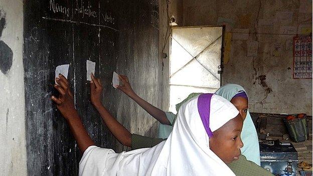 Children at a blackboard in Nigerian school