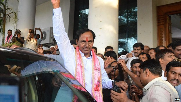 Indian Telangana Rashtra Samithi (TRS) party president K Chandrasekhar Rao (C) greets supporters in Hyderabad on 16 May 2014.