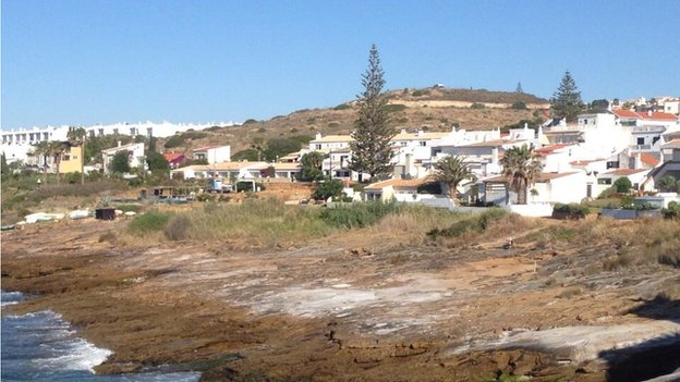 Praia da Luza - police van on top of hill in background is part of search in police investigation into disappearance of Madeleine McCann