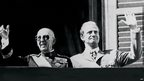 A file photo taken in October 1975 shows then Spanish head of state General Francisco Franco (L) and the then Prince Juan Carlos saluting the crowd in Madrid.