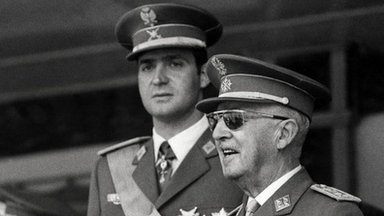 A photo taken on June 10, 1971 shows Prince Juan Carlos of Bourbon (L) and Spanish Head of State General Francisco Franco (R) attending the Victory Parade in Madrid
