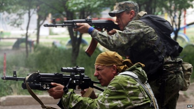 Pro-Russian gunmen fire at Ukrainian border guards in the Luhansk region. Photo: 2 June 2014