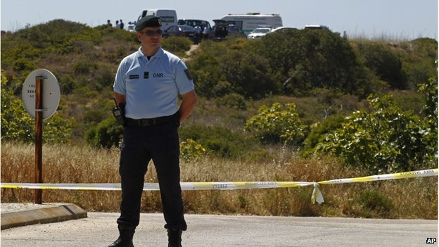 A Portuguese police officer guarding a cordon of police tape