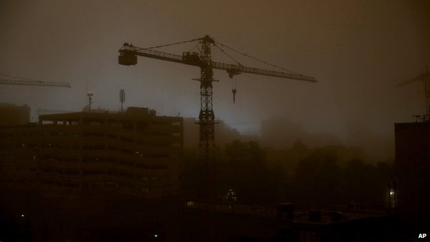 A tower crane is is enveloped in dust during a sandstorm in Tehran, Iran, 2 June 2014