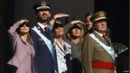 Members of the Spanish royal family (from L to R) Princess Letizia, Crown Prince Felipe, Infanta Elena, Infanta Cristina and King Juan Carlos watch a military parade during Spain's National Day in Madrid