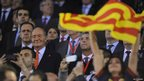 King Juan Carlos (L) of Spain looks on beside a Catalonian flag during the Copa del Rey Final between Real Madrid and Barcelona at Estadio Mestalla on April 16, 2014 in Valencia, Spain