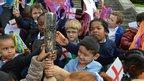 Children holding the baton in Sunset Park, Birmingham
