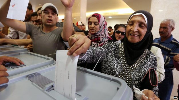 "A Syrian woman who lives in Lebanon casts her ballot for her country""s presidential election at the Syrian embassy in Yarze, east of Beirut, Lebanon, Wednesday, May 28"