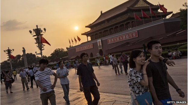 A Chinese couple walks outside the Forbidden City at Tiananmen Square on June 2