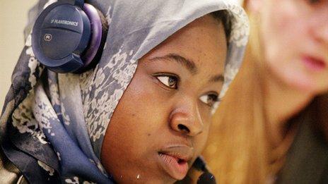 student with headphones