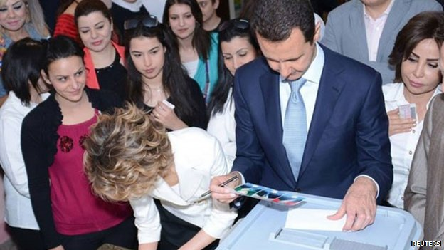 Syria's President Bashar al-Assad and his wife Asma cast their votes, 3 June