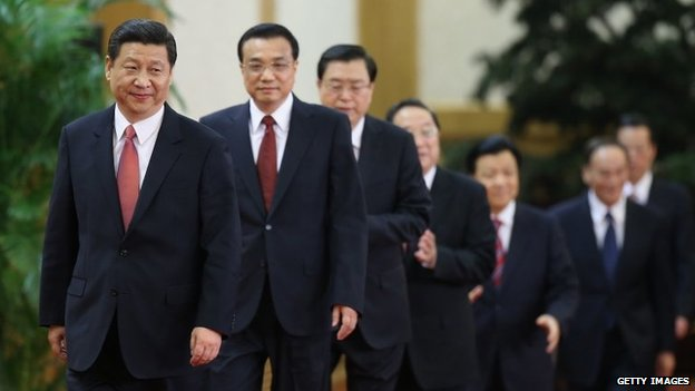 (L-R) Xi Jinping, Li Keqiang, Zhang Dejiang, Yu Zhengsheng, Liu Yunshan, Wang Qishan and Zhang Gaoli greet the media at the Great Hall of the People on November 15, 2012 in Beijing, China.