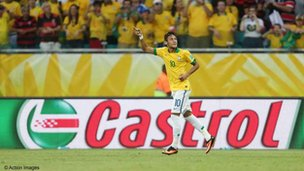 Brazilian player Neymar against a Castrol hoarding