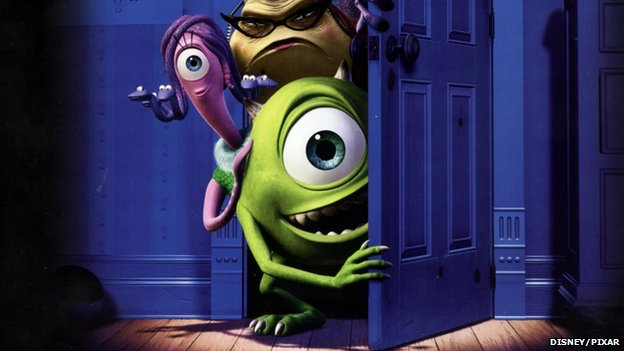 A publicity still from Monsters Inc showing a green monster with one big eye peering from behind a wardrobe door.
