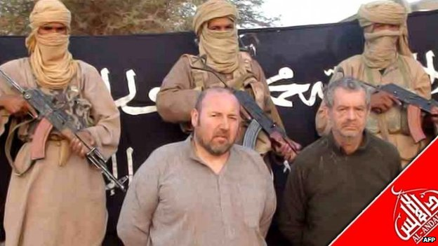 File photo: French national Serge Lazarevic (centre) and Philippe Verdon (right) being held by AQIM at an undisclosed location in 2011