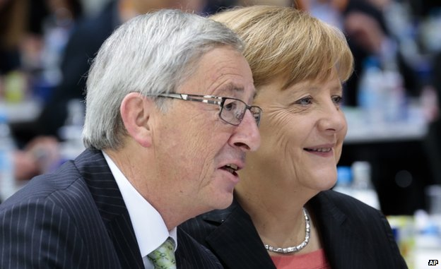 Jean Claude Juncker with German Chancellor Angela Merkel (5 April 2014)