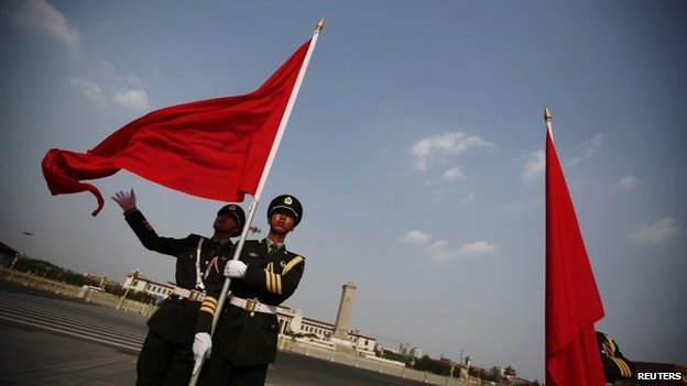 Chinese honour guards in front of the Monument to the People's Heroes at Tiananmen Square in Beijing, 3 June 2014