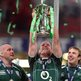 John Hayes and Stephen Ferris watch Paul O'Connell lift the Six Nations trophy after Ireland beat Wales in Cardiff to clinch the Grand Slam in March 2009