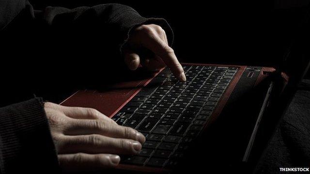 Man types laptop