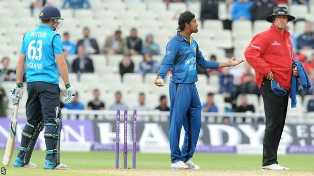Sri Lanka's Sachithra Senanayake, middle, appeals to umpire Michael Gough, right, for a run out decision on England's Jos Buttler