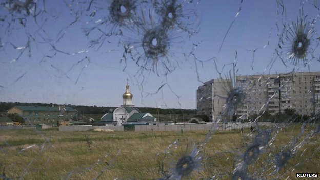 A Ukrainian border command centre is seen through bullet holes in a lorry's windscreen near Luhansk. Photo: 3 May 2014