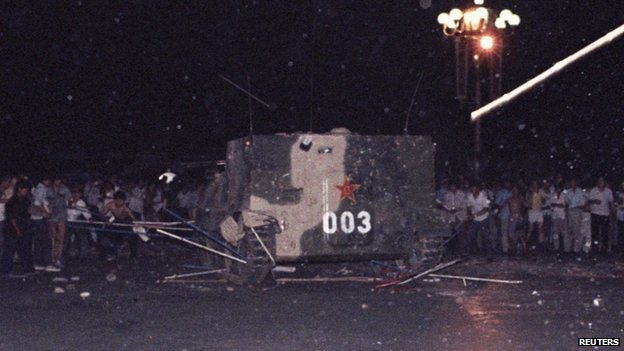 An armoured personnel carrier crushes one of the tents set up on Tiananmen Square. Photo: 4 June 1989