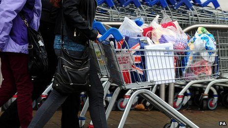 Customers with their shopping leave a Tesco store
