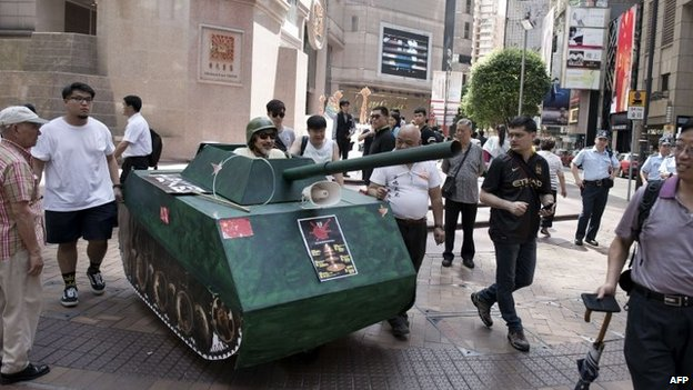 Activists walk with a replica of a Chinese tank in Hong Kong to commemorate the 1989 Tiananmen Square military crackdown in Beijing on pro-democracy protesters, on June 4