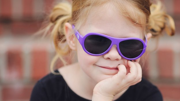 A young girl wearing Babiator sunglasses