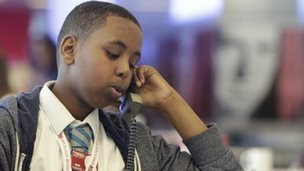 Student researches a news story on the phone