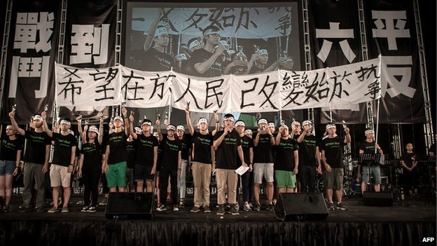Students address the crowd to commemorate China's 1989 Tiananmen Square events during a candlelight vigil in Hong Kong on 4 June 2014.
