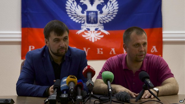 Denis Pushilin, Chairman of self-declared Supreme Council of Donetsk People's Republic, left, and Alexander Borodai, Republic's Prime Minister, speak to the media in Donetsk, Ukraine, on Thursday, May 29