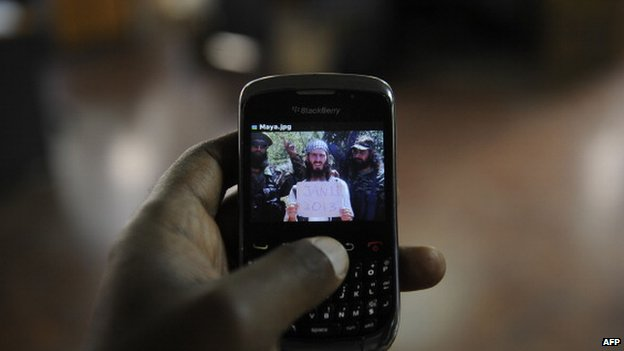 An undated photo of al-Amriki taken at an undisclosed location is seen on a mobile phone screen in Nairobi, Kenya in February 2013