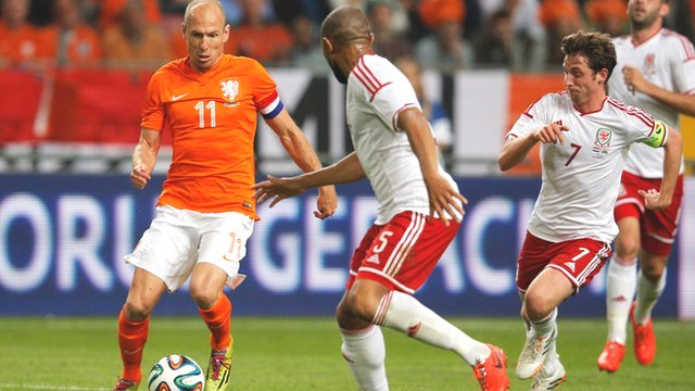 Arjen Robben of the Netherlands takes on Wales