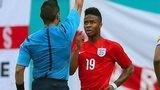 Referee Jair Marrufo shows Raheem Sterling of England