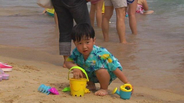A little boy on a beach