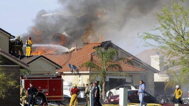Fire fighters at scene of jet crash in Yuma, California (4 June 2014)