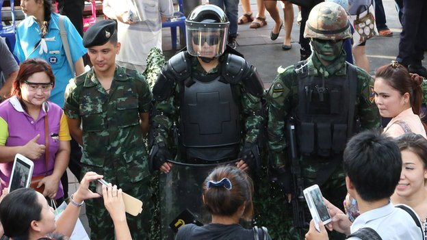 "People take photos of Thai special forces officers during an event called ""Return Happiness to Thai People"" at Bangkok's Victory Monument in Thailand on Wednesday, 4 June, 2014"