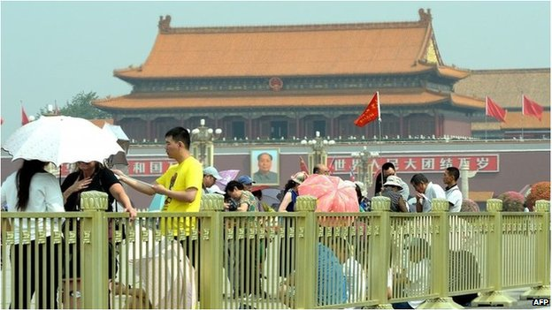 Visitors gather on Tiananmen Square in Beijing on June 4