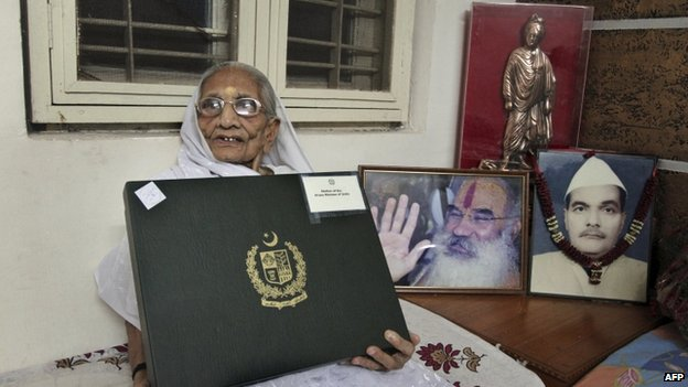 Hiraben, mother of India's prime minister Narendra Modi, displays a box with a white sari inside gifted to her by Pakistani Prime Minister Nawaz Sharif in Gandhinagar, India, Thursday, June 5, 2014.