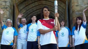 Dame Kelly Holmes with the baton