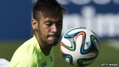Brazilian national football team player Neymar controls the Adidas Brazuca ball in training