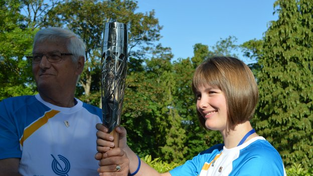 Millie Knight and another baton bearer