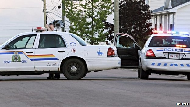 Police take cover in Moncton. 4 June 2014