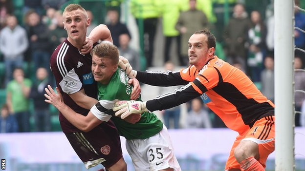 Hearts and Hibs players tussle inside the penalty box