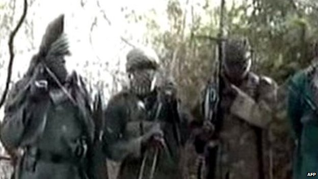 A picture taken from a video distributed to some Nigerian journalists and obtained by AFP on 5 March 2013 showing hooded Boko Haram fighters in an undisclosed place