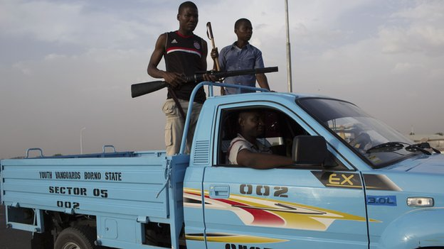 Members of civilian joint task force patrol in Maiduguri on 22 May 2014.