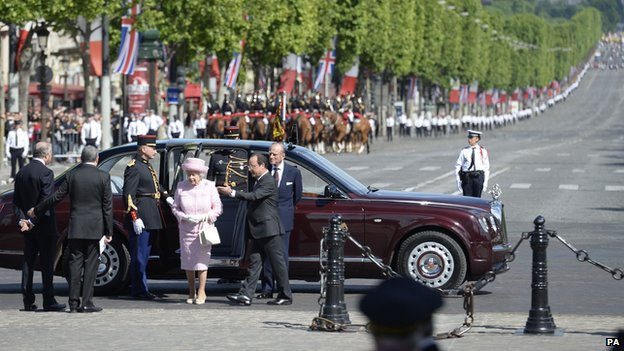 Queen Elizabeth II is greeted by the French President Francois Hollande as she arrives at the Arc de Triomphe, Paris, during a State visit to France June 5